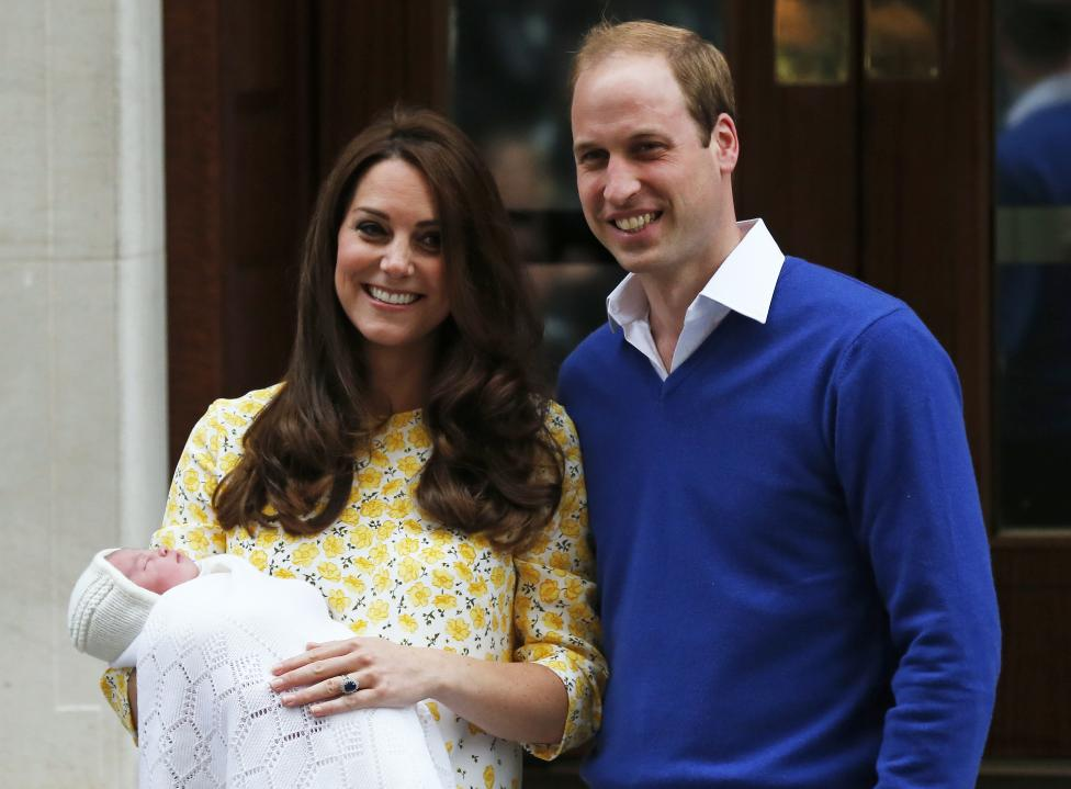 Britain's Prince William and his wife Catherine, Duchess of Cambridge, appear with their baby daughter outside the Lindo Wing of St Mary's Hospital, in London, Britain May 2, 2015. The Duchess of Cambridge, gave birth to a girl, the couple's second child and a sister to one-year-old Prince George. REUTERS/Suzanne Plunkett